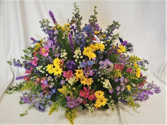 Wildflower Meadow Casket Spray from Aladdin's Floral in Idaho Falls